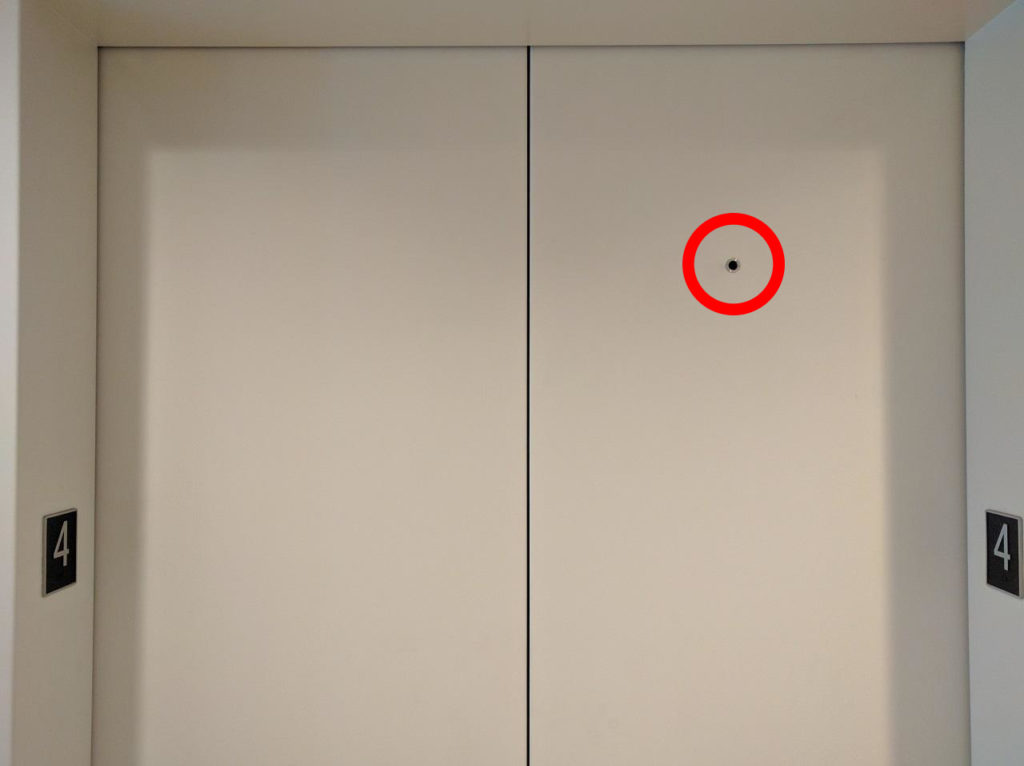 The Tiny Hole in Elevator Doors