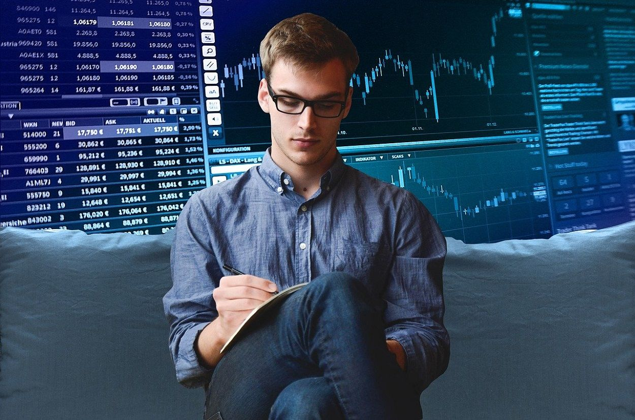 A young investor analyzing trading graphs