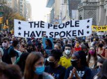 People gather as they celebrate Joe Biden's election victory in Philadelphia, Pennsylvania, last week. Photograph: Rachel Wisniewski/Reuters