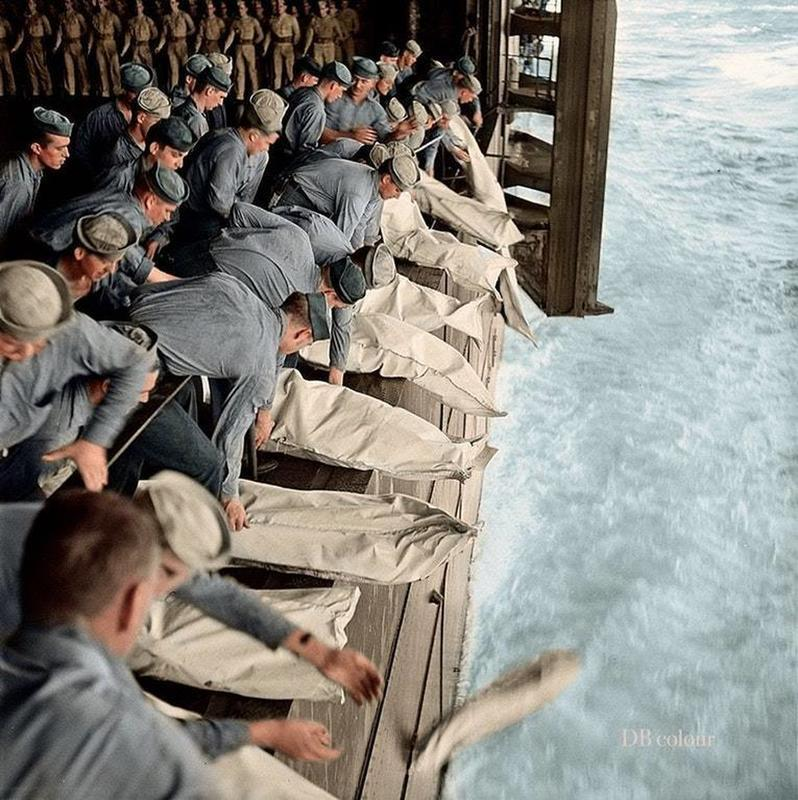 At least 10 men being buried at sea from the USS Intrepid