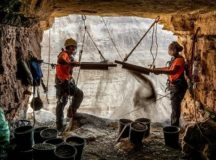 """Archeologists Hagay Hamer and Oriah Amichai sifting finds at the """"Cave of Horror"""" in the Judean Desert.Eitan Klein / Israel Antiquities Authority"""